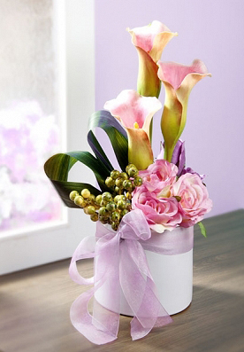 Add a soft touch to floral arrangements with a bow made of organza ribbon.