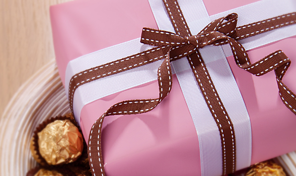 Gift wrapped in pink counter roll with layered grosgrain bow