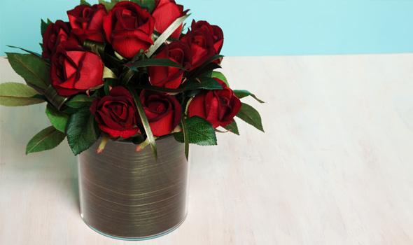 A floral arrangement using aspidistra leaf and roses.