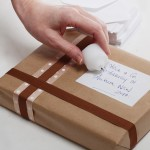 Using old candles to seal a parcel label
