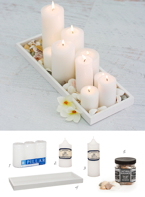 DIY candle decorations using a wooden tray, pillar candles and seashells