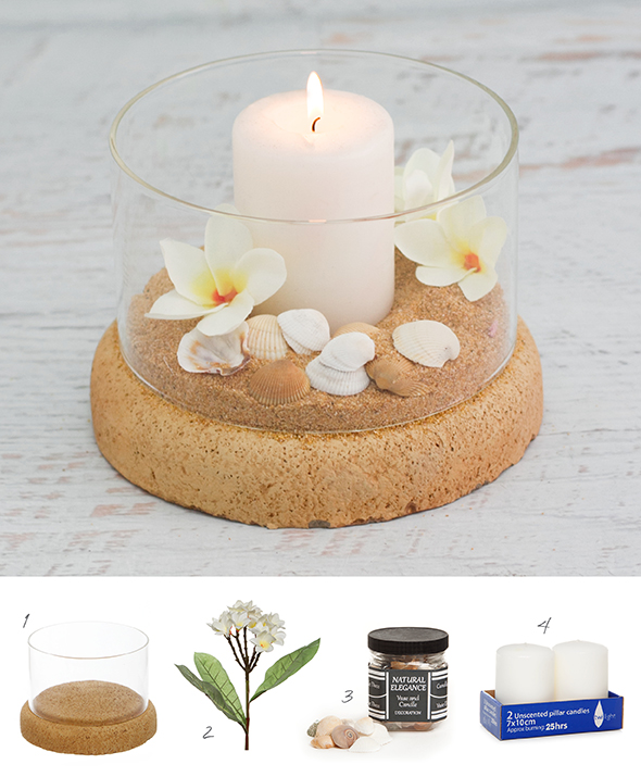 A tropical DIY candle decoration using pillar candles, flowers and seashells.