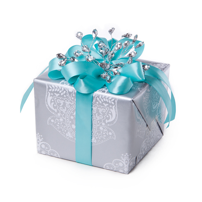 A gift wrapped with silver gift wrap and tiffany blue satin ribbons