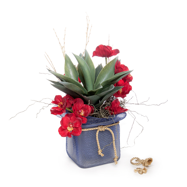 A blue potted arrangement decorated with gold ribbon cord